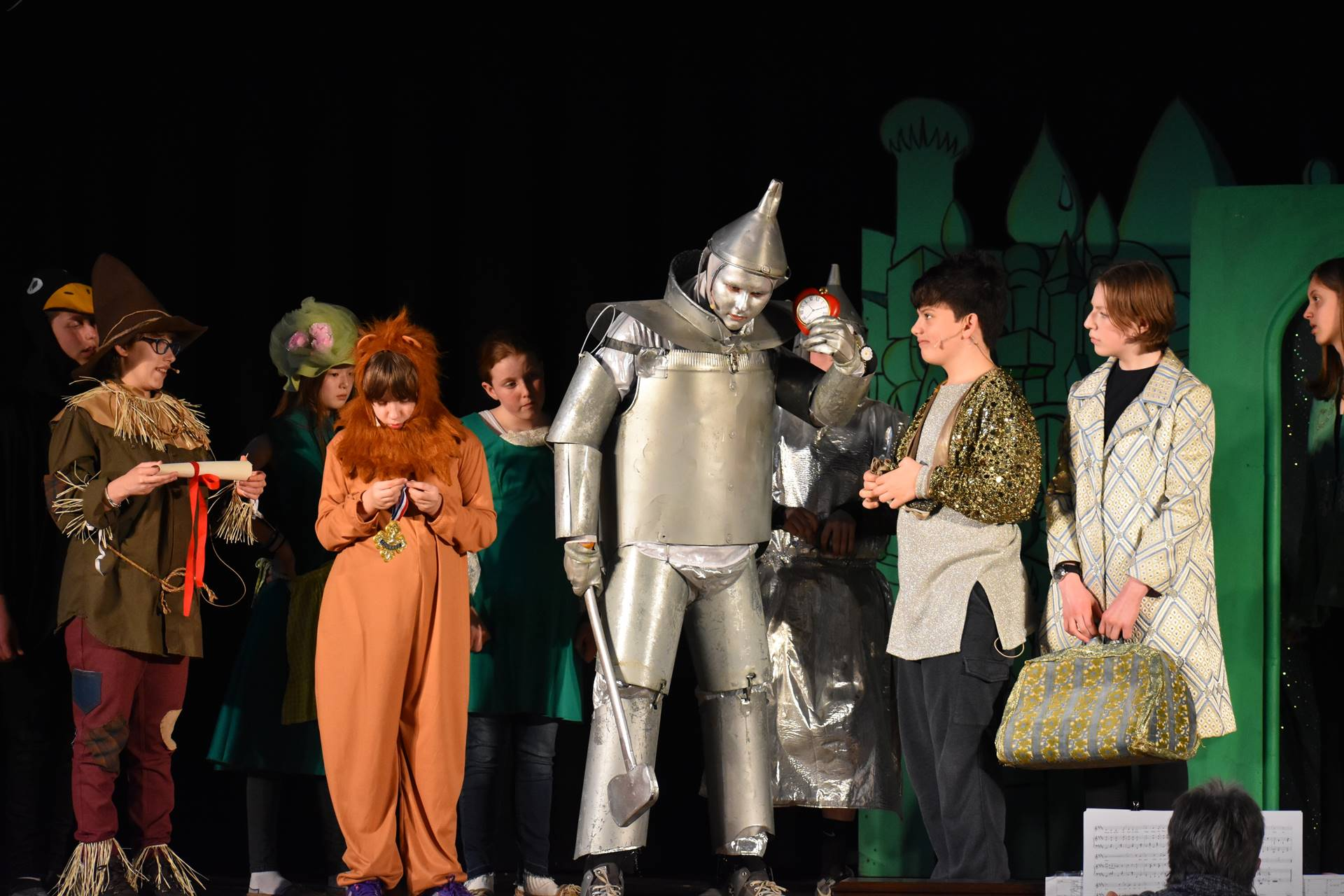 Tin Man, Lion and two male cast members and one female cast member