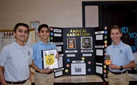 Three boys with science fair project