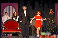 A student performance of Annie with the character Annie and Daddy Warbucks.